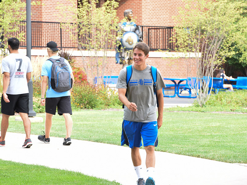 Student walking in quad.