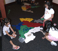 Children playing with the floor map puzzle